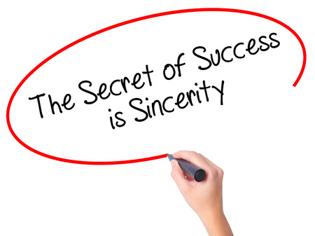 Women Hand writing The Secret of Success is Sincerity with black marker on visual screen. Isolated on white. Business, technology, internet concept. Stock Photo