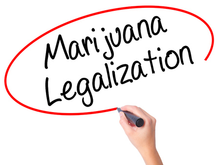legislators: Women Hand writing Marijuana Legalization with black marker on visual screen. Isolated on white. Live, technology, internet concept. Stock Photo Stock Photo