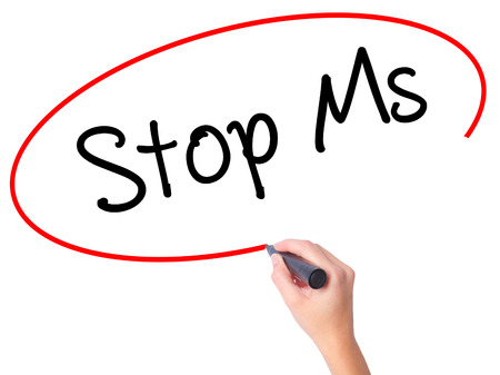 spasms: Women Hand writing Stop Ms with black marker on visual screen. Isolated on white. Business, technology, internet concept. Stock Photo