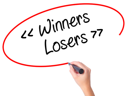 Women Hand writing Winners - Losers  with black marker on visual screen. Isolated on white. Business, technology, internet concept. Stock Photo
