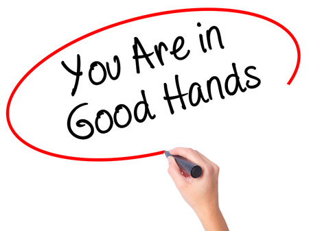 best ad: Women Hand writing You Are in Good Hands with black marker on visual screen. Isolated on white. Business, technology, internet concept. Stock Photo