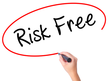 Women Hand writing Risk Free with black marker on visual screen. Isolated on white. Business, technology, internet concept. Stock Image