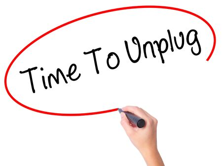 unplug: Women Hand writing Time To Unplug with black marker on visual screen. Isolated on white. Business, technology, internet concept. Stock Photo