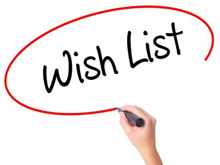 Women Hand writing Wish List with black marker on visual screen. Isolated on white. Business, technology, internet concept. Stock Photo