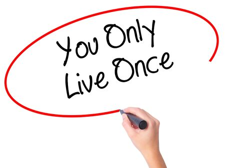 Women Hand writing You Only Live Once with black marker on visual screen. Isolated on white. Business, technology, internet concept. Stock Photo