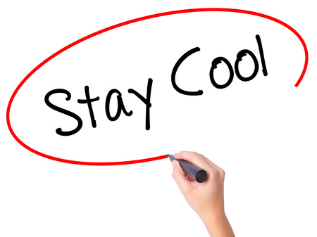 Women Hand writing Stay Cool   with black marker on visual screen. Isolated on white. Business, technology, internet concept. Stock Photo