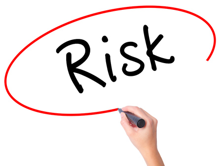 reduce risk: Women Hand writing Risk with black marker on visual screen. Isolated on white. Business, technology, internet concept. Stock Image Stock Photo