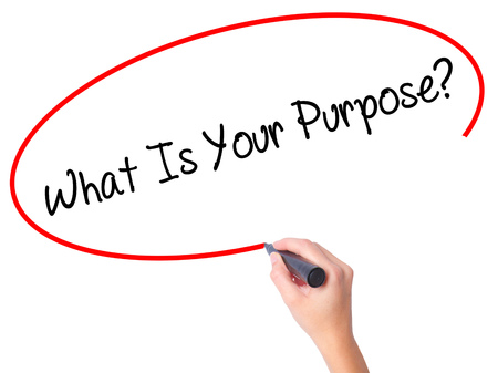 Women Hand writing What Is Your Purpose?  with black marker on visual screen. Isolated on white. Business, technology, internet concept. Stock Photo