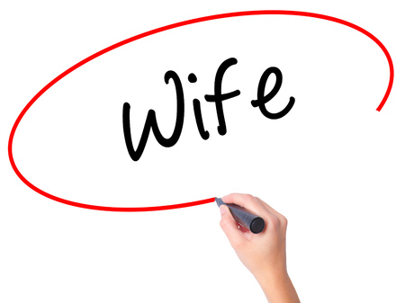 Women Hand writing Wife with black marker on visual screen. Isolated on white. Business, technology, internet concept. Stock Photo