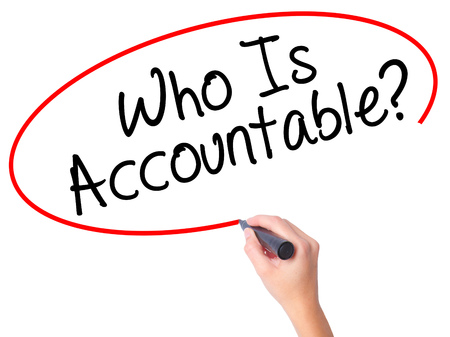 obligated: Women Hand writing Who Is Accountable? with black marker on visual screen. Isolated on white. Business, technology, internet concept. Stock Image Stock Photo