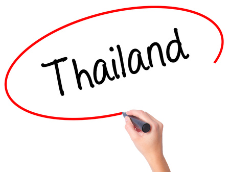 Women Hand writing Thailand  with black marker on visual screen. Isolated on white. Business, technology, internet concept. Stock Photo