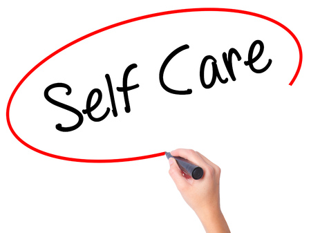 self care: Women Hand writing Self Care with black marker on visual screen. Isolated on white. Business, technology, internet concept. Stock Photo