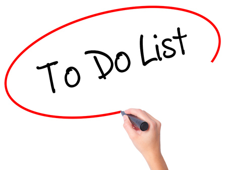 todo list: Women Hand writing To Do List with black marker on visual screen. Isolated on white. Business, technology, internet concept. Stock Photo