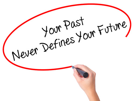 defines: Women Hand writing Your Past Never Defines Your Future with black marker on visual screen. Isolated on white. Business, technology, internet concept. Stock Photo Stock Photo