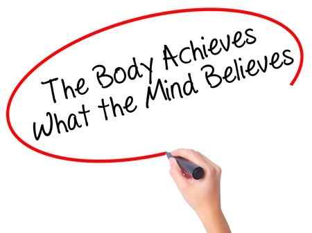 believes: Women Hand writing The Body Achieves What the Mind Believes with black marker on visual screen. Isolated on white. Business, technology, internet concept. Stock Photo Stock Photo