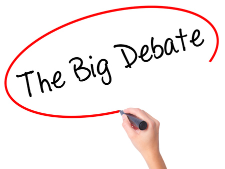 Women Hand writing The Big Debate with black marker on visual screen. Isolated on white. Business, technology, internet concept. Stock Photo