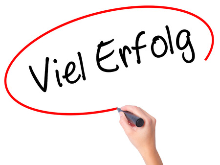 Women Hand writing Viel Erfolg (Much Success In German) with black marker on visual screen. Isolated on white. Business, technology, internet concept. Stock Photo Stock Photo