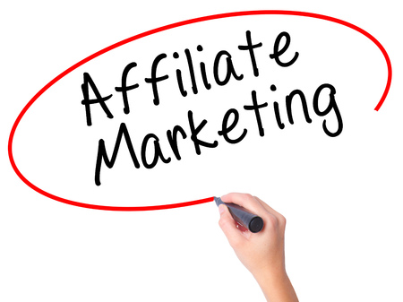 affiliation: Women Hand writing Affiliate Marketing with black marker on visual screen. Isolated on white. Business, technology, internet concept. Stock Image Stock Photo