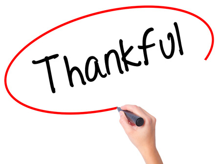 Women Hand writing Thankful  with black marker on visual screen. Isolated on white. Business, technology, internet concept. Stock Photo