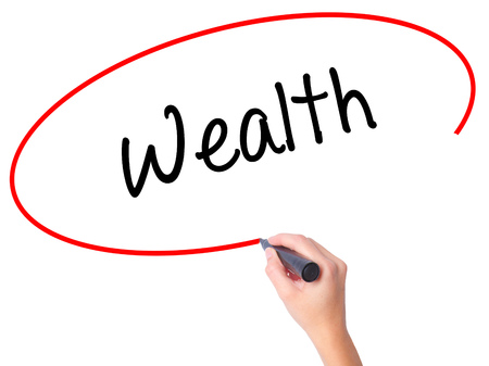 earn more: Women Hand writing Wealth with black marker on visual screen. Isolated on white. Business, technology, internet concept. Stock Photo