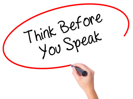 Women Hand writing Think Before You Speak with black marker on visual screen. Isolated on white. Business, technology, internet concept. Stock Photo