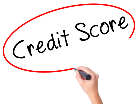 Women Hand writing Credit Score black marker on visual screen. Isolated on white. Business, technology, internet concept. Stock Image