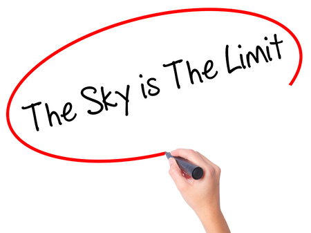 sky is the limit: Women Hand writing The Sky is The Limit  with black marker on visual screen. Isolated on white. Business, technology, internet concept. Stock Photo