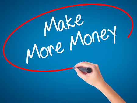 Women Hand writing Make Money Money  with black marker on visual screen. Isolated on blue. Business, technology, internet concept. Stock Photo Stock Photo