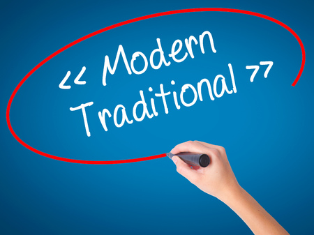 guidepost: Women Hand writing Modern - Traditional  with black marker on visual screen. Isolated on blue. Business, technology, internet concept. Stock Photo Stock Photo