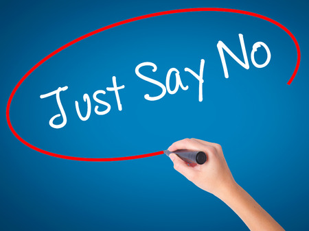 activist: Women Hand writing Just Say No with black marker on visual screen. Isolated on blue. Business, technology, internet concept. Stock Photo Stock Photo