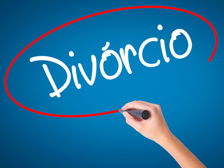 splitting up: Women Hand writing Divorcio (Divorce in Portuguese) with black marker on visual screen. Isolated on blue. Business, technology, internet concept. Stock Photo Stock Photo