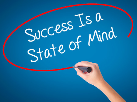 Women Hand writing Success Is a State of Mind with black marker on visual screen. Isolated on blue. Business, technology, internet concept. Stock Photo Stock Photo