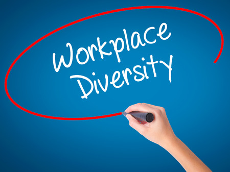 Man Hand writing Workplace Diversity  with black marker on visual screen. Isolated on background. Business, technology, internet concept. Stock Photo