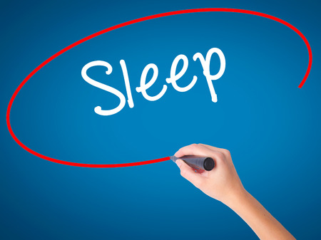 Women Hand writing Sleep with black marker on visual screen. Isolated on blue. Business, technology, internet concept. Stock Photo