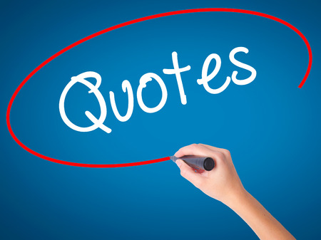 Women Hand writing Quotes  with black marker on visual screen. Isolated on blue. Business, technology, internet concept. Stock Photo