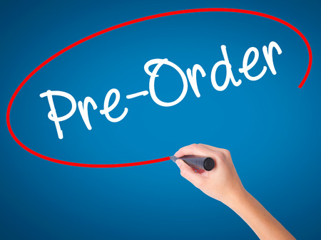 preorder: Women Hand writing Pre-Order  with black marker on visual screen. Isolated on blue. Business, technology, internet concept. Stock Photo