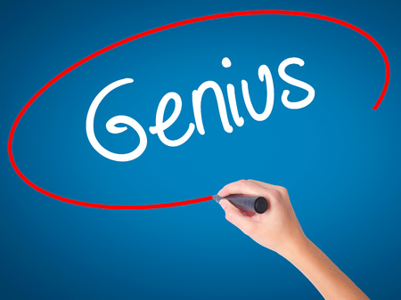 savant: Women Hand writing Genius  with black marker on visual screen. Isolated on blue. Business, technology, internet concept. Stock Photo