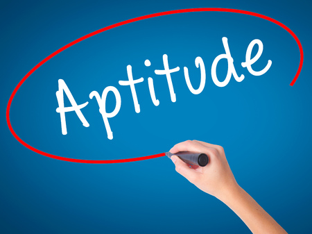 aptitude: Women Hand writing Aptitude with black marker on visual screen. Isolated on blue. Business, technology, internet concept. Stock Photo
