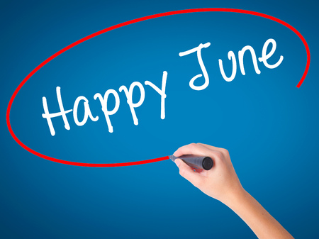 Women Hand writing Happy June with black marker on visual screen. Isolated on blue. Business, technology, internet concept. Stock Photo Stock Photo