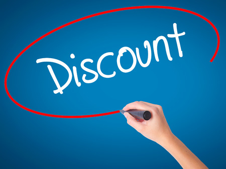 Women Hand writing Discount with black marker on visual screen. Isolated on blue. Business, technology, internet concept. Stock Photo
