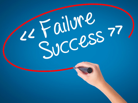 Women Hand writing Failure Success with black marker on visual screen. Isolated on blue. Business, technology, internet concept. Stock Photo