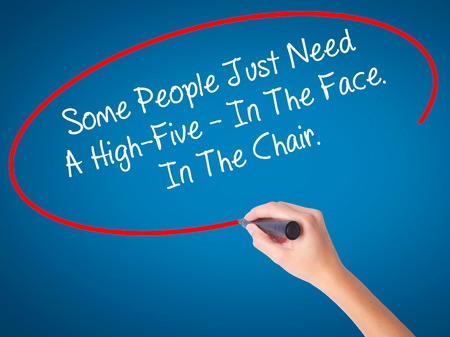 foolish: Women Hand writing Some People Just Need A High-Five - In The Face. In The Chair  with black marker on visual screen. Isolated on blue. Business, technology, internet concept. Stock Photo Stock Photo