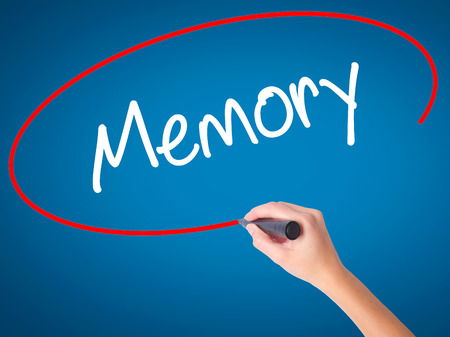 Women Hand writing Memory  with black marker on visual screen. Isolated on blue. Business, technology, internet concept. Stock Photo Stock Photo