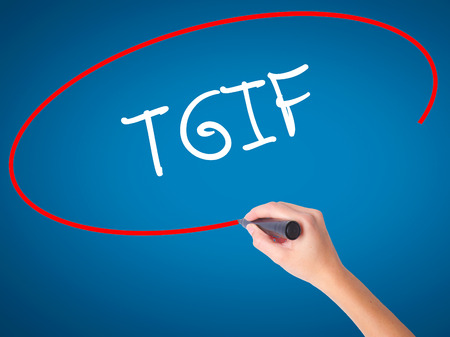 postit note: Women Hand writing TGIF with black marker on visual screen. Isolated on blue. Business, technology, internet concept. Stock Photo Stock Photo