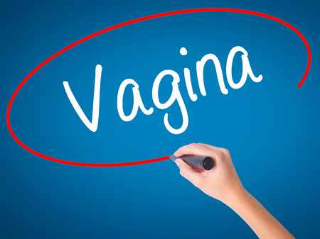mammogram: Women Hand writing Vagina with black marker on visual screen. Isolated on blue. Business, technology, internet concept. Stock Photo