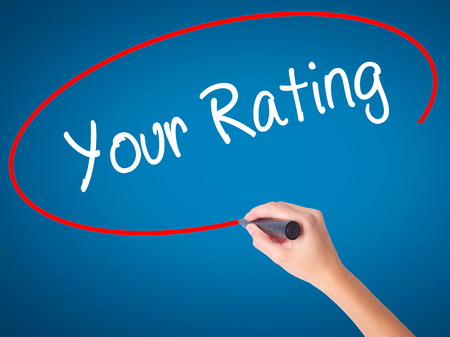 Woman Hand writing Your Rating with black marker on visual screen. Isolated on background. Business, technology, internet concept. Stock Photo Stock Photo