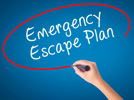 emergency plan: Man Hand writing Emergency Escape Plan with black marker on visual screen. Isolated on white. Business, technology, internet concept. Stock Image Stock Photo