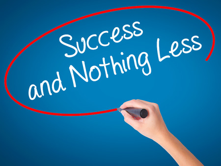 work less: Women Hand writing Success and Nothing Less with black marker on visual screen. Isolated on blue. Business, technology, internet concept. Stock Photo Stock Photo