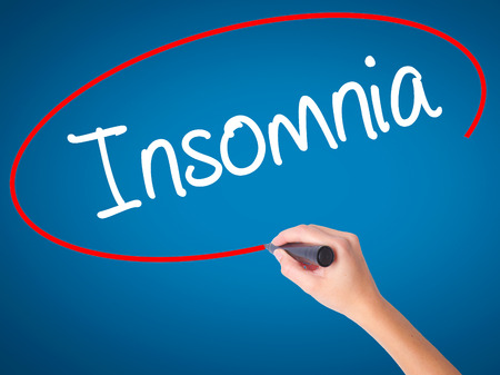 hallucinations: Women Hand writing Insomnia  with black marker on visual screen. Isolated on blue. Business, technology, internet concept. Stock Photo