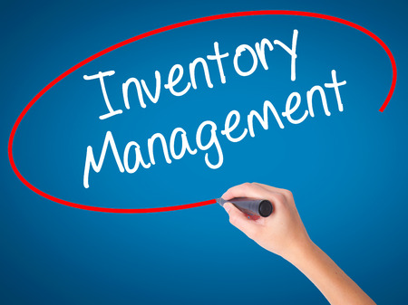 Women Hand writing Inventory Management with black marker on visual screen. Isolated on blue. Business, technology, internet concept. Stock Photo Stock Photo